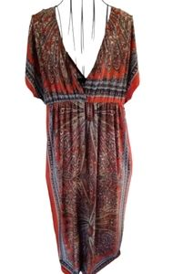 Chesley rust paisley colored maxi dress & low cut